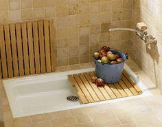 floor sink - Kohler Oceanview utility floor sink - love slatted rack covers.  Kohler via Atticmag