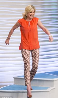 Cheerful: Anthea Turner looked beautiful and bold in an orange shirt as she…
