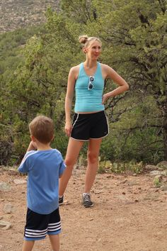 Cute casual hiking outfit with Nike shorts and a blue spandex top | Family Hike best fashion blogs