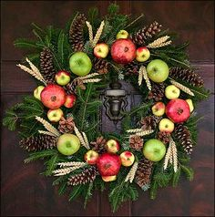 Beautiful Christmas Wreath with Apples, Pomegranates, and Pine Cones - Colonial Williamsburg.