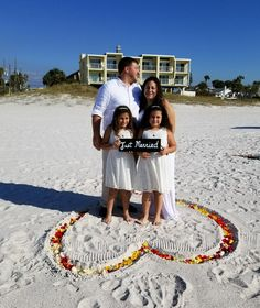 family beach wedding. Rose petal heart in the sand. Notary wedding officiant Non denominational