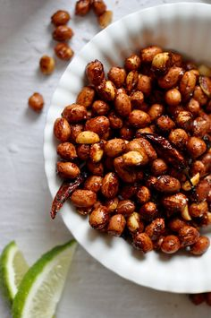 These chili lime roasted peanuts are tossed in an addictive mixture of chili, fresh lime zest, turbinado sugar, and salt then roasted to a golden brown.One of the best Mexican appetizers out there and perfect for a stay-at-home Cinco de Mayo celebration. Peanut Recipes, New Recipes, Recipies, Freezer Recipes, Freezer Cooking, Candy Recipes, Drink Recipes, Baking Recipes, Cooking Tips