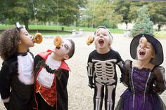 Bobbing for doughnuts on a string kids game.  See more Halloween kids games and party ideas at one-stop-party-ideas.com