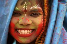 Indian girl celebrating Holi Festival