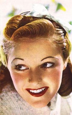 A lovely hairstyle from the March 1940 edition of Woman and Beauty. #vintage #1940s #hair