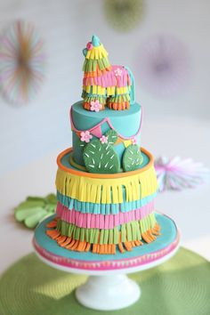 Colorful Piñata Southwest Cactus Birthday party cake on satinice.com| The Cake Topper
