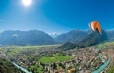 Paragliding - Interlaken, Switzerland. Enjoy the breathtaking bird's eye view as you take in from above the mountain and lake scenery that surrounds Interlaken.