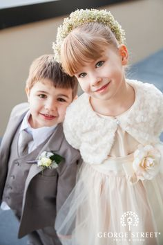 Formal ring bearer and flower girl fashion for an elegant winter wedding
