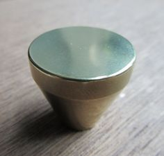 "The Roma decorative cabinet knob for either cabinet doors or drawers is supplied with a machine screw for through-bolting. It measures 1-1/4"" in diameter.  Also available in 1 1/2"", 1"", and 3/4""   Finishes available: Polished brass, Polished Bronze, Polished stainless steel, Satin stainless steel."