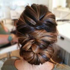 Pretty updo, but her hair color is really pretty