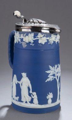 "Wedgwood blue lidded tankard c. 1780-1795.  Wedgwood England blue tankard with marked silverplate lid. c. 1780-1795. Impressed, ""Wedgwood/24/F"" on bottom. 7 1/2""h x 4""diam."