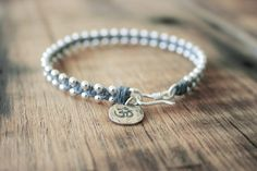 Yoga Beaded Bracelet with Om Charm - Waxed Irish Linen - Slate Grey Bracelet with Sterling Silver Beads and Thai Silver Hook Clasp