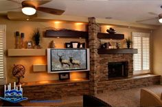 custom entertainment centers with fireplace Bookshelves Around Fireplace, Fireplace Tv Wall, Basement Fireplace, Fireplace Design, Tv Mantle, Off Center Fireplace, Vaulted Living Rooms, Tv Unit Decor, Entertainment Wall Units