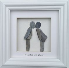 A pebble couple sharing their first kiss makes a perfect Valentines gift and as an added romantic bonus for Valentines Day Ill add a sea glass heart to this picture. Set inside a 20cm x 20cm glazed box frame in either black or white.