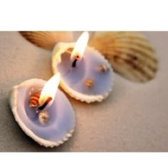 Seashell candles. Easy to make and wonderful for a beach wedding table setting.