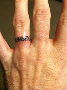 Awesome Tattoo My Husband Got Our Anniversary In Roman Numerals On His Ring Finger