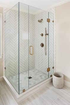 Master bathroom shower with white herringbone tiles and gray grout features perfect dimensional patterns.