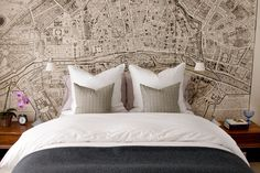 you can have a map printed out as wallpaper to fit your exact space, how cool is that??? this is a vintage map of Paris, would LOVE behind the bed in upstairs bedroom!!