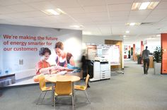 Full wall FabriFrame graphics applied in a busy office setting