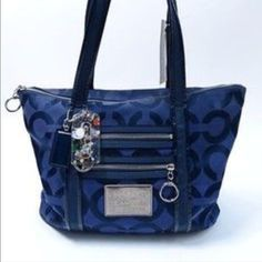Coach poppy glam tote Lightly loved Coach poppy bag. Navy blue color with silver hardware. The outside is in good condition and there is some slight discoloration on the inside pockets from use. Priced accordingly. Hang tags included as well! Received as a gift and I haven't used it in a while. Really pretty and versatile tote for a fraction of the price!! Coach Bags Totes