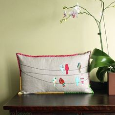 Google Image Result for http://g-cdn.apartmenttherapy.com/1287059/032910-spring-cushion-birds-wire_rect540.jpg