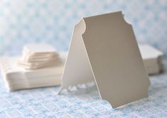 Card stock with corner hole punches for earring stands and packaging