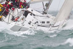 A J/109 yacht in choppy seas racing during Aberdeen Asset Management Cowes Week. #sailboats #boats #sailing