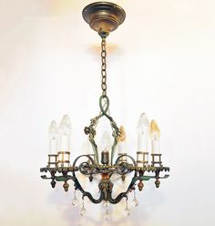 brass & iron chandelier with original paint by lion electric fixtures