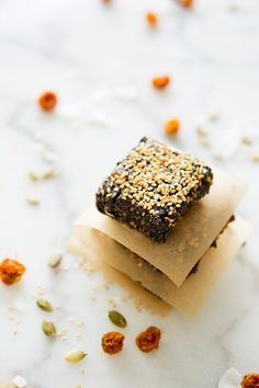 BLACK SESAME ENERGY BARS  Makes approximately 12 bars     Ingredients:  2 cups black sesame seeds  1/3 cup + 1 tablespoon coconut flakes  1/2 cup golden berries    1/6 cup pumpkin seeds  3 tablespoons flax  1/4 teaspoon sea salt  2 tablespoons coconut oil  white sesame seeds to garnish