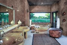 Fullscreen Photos - Sculpted into a slope of the earth, Earth Lodge's organic architecture awakens the senses with a masterful use of texture, space and light. Stone Bath, Plunge Pool, Organic Architecture, Wine Cellar, Luxury Travel, Natural Stones, Indoor, Earth, Colours
