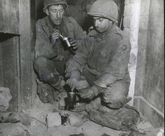 Dinner time for PFC. Edward E. Gladsford (left) and PFC. Oscar L. Lombardi, from  the 9th infantry division.