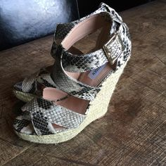 Steve Madden snakeskin wedges size 8 Super cute and easy to wear wedges. Very minimal wear. Two small spots of discoloration, one not visible (closure blocks it). Steve Madden Shoes Wedges
