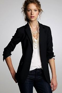 Black suit, gold layer necklace white v neck tee