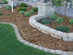 I like the low row as edging and the higher row as a raised bed. I would plant in between instead of mulching. Keystone Insignia Landscaping Edging Stones