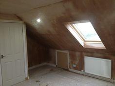 Newly plastered velux window installation.