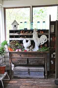 potting bench and white rooster and hen Porches, Farmhouse Style, Farmhouse Decor, Potting Tables, Rooster Decor, Big Rooster, Rooster Kitchen, Chickens And Roosters, French Country Decorating