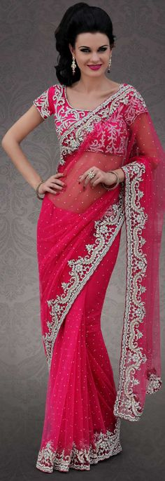 Breathtaking collection of sarees with stylish embroidery work and fabulous style.   This pink net saree is nicely designed with embroidery patch work is done with stone and cutbeads work.   Beautiful embroidery work on saree make attractive to impress all.   This saree gives you a modern and different look in fabulous style.   Matching blouse is available.   Slight color variations are possible due to differing screen and photograph resolution.