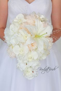 Pearl Davids Bridal Wedding Flowers with white lilies, white orchids, bellini peonies on bellini bridesmaids dresses with pearls