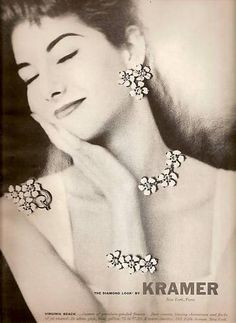 idea: take old magazines/pictures and pin or lace the jewelry through it