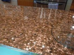 Don't laugh, but I want to try this on something. // DIY penny countertop -- could do this on an old table top.