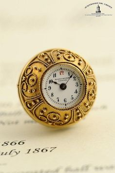 A very fine, rare and early gold enamel ball watch studded with diamonds, sold…