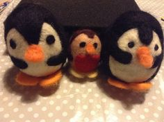 Felted penguins and robin