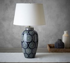 The stamped-ceramic finish of the Langley Ceramic Cylinder Lamp is done by hand and recalls the blue-and-white motifs from cultures around the globe. Made of ceramic with a linen shade. Pottery Barn Lamps, Lamp, Table Lamp Base, Vase Lamp, Ceramic Table Lamps, Lamps Living Room, Blue Decor, Home Decor, Pottery Barn Table