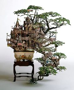 Takanori Aiba makes incredibly detailed sculptures using stone clay, epoxy putty, plastic, resin and copper line. His sculptures include lighthouses, balconies, bridges, towers and buildings.