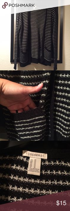 Forever 21 Cardigan Black and white color. This cardigan has pockets and it is so perfect for fall. Material has a bit of a stretch so it fits very comfortably! Worn once. Pair with skinny jeans and boots! Forever 21 Sweaters Cardigans