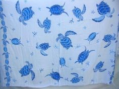 white sarong with blue sea turtle - http://www.wholesalesarong.com/blog/white-sarong-with-blue-sea-turtle/