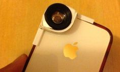 Old digital camera lens over a smart phone lens--great hack for taking better phone pics