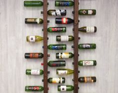 ***CURRENTLY SOLD OUT - SECURE YOUR SET TODAY!!*** WE ARE WORKING ON A NEW BATCH AND IT WILL BE READY IN MID JANUARY 2017. ONCE THEY ARE READY WE WILL SHIP IMMMEDIATELY.   ***Holds full bottles of wine***  These 16 bottle wine racks work together in perfect harmony. Hewn from rough wood and aged copper accents, they interlock together to optimize space. The design is also perfect for cork preservation. At 70 tall, it will fit comfortably with most ceiling heights Want to Personalize your…