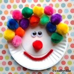 Clown paper plate craft.  Could also use bingo markers for hair but pom poms make a fun 3-D look.