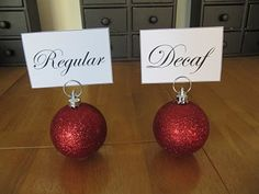 Party ideas: glue plastic ring on the bottom of ornament to keep it from rolling and attach ring to top to hold cards. cute place card holders for table too! Little Christmas, All Things Christmas, Winter Christmas, Christmas Holidays, Christmas Decorations, Christmas Balls, Christmas Place Cards, Christmas Buffet, Table Decorations
